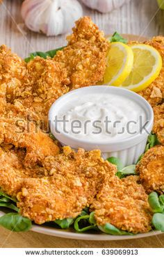 Chicken strips with delish garlic dip, food photography