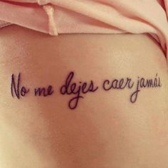 "Little rib tattoo saying ""No me dejes caer jamás"" in Spanish, which means ""Do not let me fall ever""."