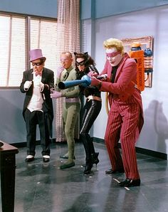 A Bevy of Batman Villains attempt to inconvenience the dynamic duo. Lee Meriwether as Catwoman, Frank Gorshin as The Riddler, Burgess Meredith as Penguin and Cesar Romero as The Joker. Adam West Batman, Batman Y Robin, Batman 1966, Im Batman, Batman Riddler, Gotham Batman, Batman Art, Movies And Series, Tv Series