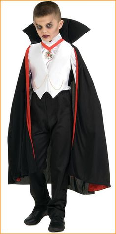 #882819/10609 He'll rule the night this Halloween as the Dracula boy. The Dracula Boy Costume includes a black cape with red lining and stand-up collar. A white button down shirt, black pants and whit