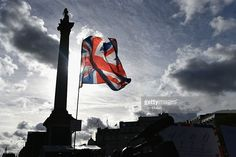 The Great Britain flag is lofted in the air during the Olympics & Paralympics Team GB - Rio 2016 Victory Parade at Trafalgar Square on October 18, 2016 in London, England.