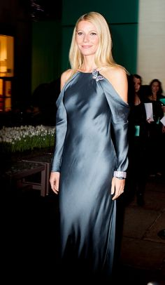 Long evening dress with cut out shoulders. Love the color.