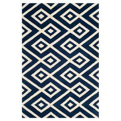 Hand-tufted in India, this wool rug's captivating diamond motif is highlighted by a rich dark blue palette.  Product: Rug