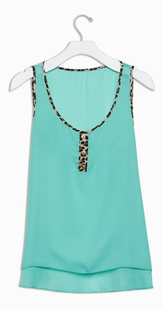 Cute, sheer tank in aqua with leopard trim Love me some leopard print