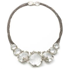 Silver_Gaze Marquis Cluster Bib Necklace. Style: FN44N021 Large rounds of custom cut Clear Quartz are edged with marquis claw prongs in Light Oxidized Sterling Silver with accents of Light Green Sapphire and pav� Light Grey Diamond. This gleaming, stone bib is paired with multiple strands of chain adding a grunge element to this ladylike style. 1438.00 sale orig 3595.00 Oct 2016