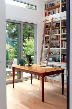 Aim High: What to Know About Adding a Library Ladder. Contemporary Home Office by blurrdMEDIA