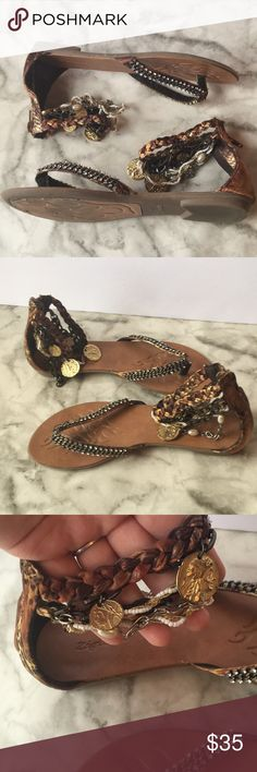 Zigi Soho Bohemian Chic Sandals Zigi Soho Sandals With Bohemian Chic style. Has coins, chains and beads around the ankles and animal print on fabric behind the heel of the shoe. Worn maybe five times. Size 6. Comes with protective dust bags. I no longer have the box.  💜Make a reasonable offer! Or use the bundle button & I'll send you an offer💜 Zigi Soho Shoes Sandals