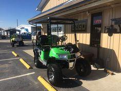 """First ever, custom painted lime green """"Palmetto"""" 2011 E-Z-GO RXV Golf Cart with custom seats, 12"""" tires & wheels, 6"""" lift, lights, extended top, stainless steel brush guard & tops out at 27 mph!!!!"""