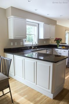 Budget kitchen remodel with refaced cabinets and new granite