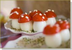 """De jolis oeufs chapeautés d'une tranche de tomate, un semis mayonnaise sur un lit persillé."" ~ Translation: Pretty umbrella eggs with a slice of tomato, a sprinkling parsley mayonnaise on a bed.  There's no recipe for these cute little bites, but I saw them on a french blog & had never seen anything like them.  I'm imagining boiled egg, little mayo, topped with cherry tomato & seasonings... but what do you think?"