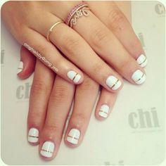 White nail art with gold accent
