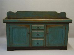 Early dry sink with two doors and three drawers in original blue paint.  google.com