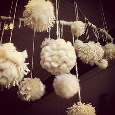 "Window display of ""snowball"" pom poms by Modern Fiber Lab - Sonya Yong James, via Flickr"