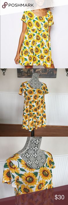 American Apparel Sunflower Dress Worn a couple of times. Baby doll style dress, with empire waist and full skirt. Light and comfy! American Apparel Dresses