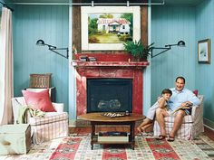 hidden tv on mantle | Artwork above mantel is on a sliding track to hide tv | For the Home