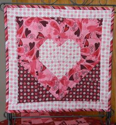 One of many cute pictures of table topper quilts from the cuddle quilter