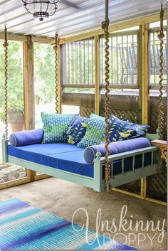 hanging bed on a sleeping porch i love the rope wrapped around the chains to make it look more natural