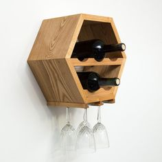 This hexagon wine rack makes the perfect gift! A creative way to store wine while adding a touch of style to any space, this system can grow with your collection! Each rack can hold up to 7 bottles with minimal wasted space and is ready to hang, but work just as well for counter tops and tables. We now offer a unique way to hang wine glasses from the bottom of the rack - see the listing below for more information. Pictures: 1.) Ash hardwood with Walnut stain (shows glass holders) 2.) Walnut…
