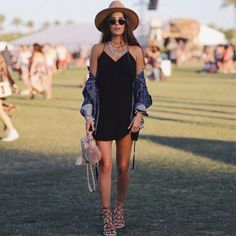 Retro sunnies, a shift dress with a denim jacket, lace-up sandals, and layered necklaces.