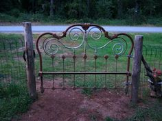 Funky Junk Jennifer - an old iron bed head board. such a neat idea for a outdoor gate, decor Outdoor Projects, Garden Projects, Outdoor Decor, Iron Headboard, Antique Headboard, Garden Junk, Fence Gate, Porch Gate, Garden Gates And Fencing