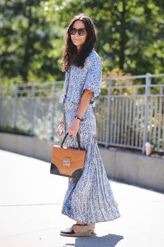 The Most Authentically Inspiring Street Style From New York #refinery29  http://www.refinery29.com/2015/09/93788/ny-fashion-week-spring-2016-street-style-pictures#slide-5  A sleek back contrasts against a full-length floral print....