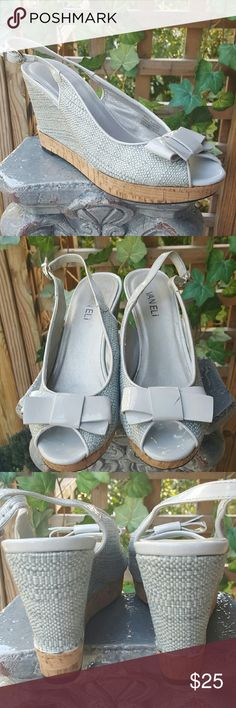 "Woven Gray Slingback Platform Wedge Cork detail and thin silver trim on covered 4"" heel. Patent leather bow on one shoe has a small black mark on it. These classy summery wedges are 9.5 NARROW. Excellent condition. Vaneli Shoes Wedges"