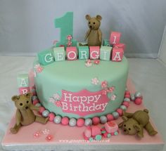 Pretty pink and mint green cake for a 1 year old