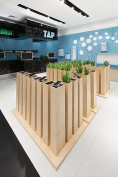 AER, retail design. *solar powered cell charger area covered in grass/ flowers  ( more likely the grass wall with small pockets to put cell phone/ charge) maybe included ipads for lookbook ideas and mirrors, etc