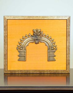 PRABHAVALI'S ANTIQUE BRASS - Give your wall an exotic and elegant touch with this antique brass set in a frame.