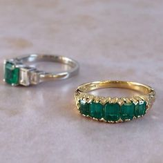 An elegant Victorian style half hoop ring, featured on the right. Our Five emerald-cut emeralds spread across the ring in a scrolled and carved yellow gold setting. Ring Model No: Unusual Engagement Rings, Victorian Engagement Rings, Vintage Style Engagement Rings, Emerald Cut Rings, Green Gemstones, Fashion Rings, Ring Designs, Emeralds, Victorian Era