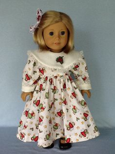 A very pretty Christmas dress.  For this dress I used a Daisy Kingdom pattern and an ivory holiday print. The cola are and cuffs are made from a linen like fabric.  The bodice features a rounded collar, cuffed sleeves, belt ties, and closes in the back with Velcro. I added lace and button trim for added interest.  The gathered skirt is ankle length. A hair ribbon is included in the order.  All seams have been surged for neatness and durability. Made in my smoke free home..