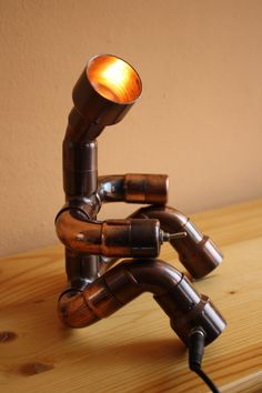 Cute light man. The lamp was made by antiqued copper fittings. It operates from 12 V and 2 W LED bulb is into head. The brightness is low, therefore I recommend for mood lamp. You can light the lamp exc wall, picture, or little statue. The head is rotating. The switch is in hand, the jack is in leg. Does not heat up, and not consume much. Mood Lamps, Can Lights, Unique Lamps, Secret Life, Antique Copper, Led Lamp, Industrial Style, Wine Rack, Table Lamp