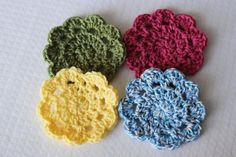 """These easy crochet coasters are the perfect things to brighten up your summertime spread. Make them in different colors and set them out for your next barbecue!<br /> As the designer says, """"these fun, scalloped coasters are great for any season! Make them in fun spring/summer colors to save your tables from rings or dress up a picnic! They work up fast in just 5 rounds and use very little yarn - a great stash buster!"""""""