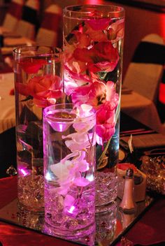 Wedding Center Pieces with Diamonds, Submersible lights, flowers and floating candles! So beautiful!