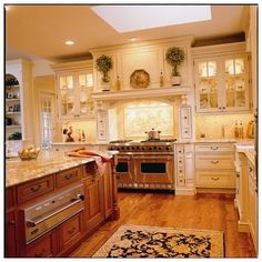 Above kitchen cabinets decor ideas: I like this... elegant, simple, but with a little whimsy... Google Image Result for http://st.houzz.com/fimgs/cd3155a00c584501_1000-w406-h406-b0-p0--traditional-kitchen.jpg