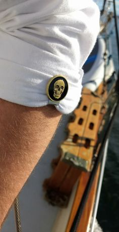 Brass skull sleeve clips. Cool invention for locking up rolled sleeves.