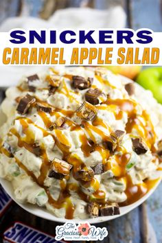 Snickers Caramel Apple Salad is actually a creamy, sweet dessert with bits of crisp, tart apples and gooey candy bar pieces. Snickers Caramel Apple Salad is one of those desserts that's no-so-cleverly disguised as a salad. Or maybe it's the other way around! Whatever it is, it's sweet and tart, crunchy and gooey, creamy and cool, and mostly just little bites of heaven! | The Gracious Wife @thegraciouswife #snickerssalad #caramelapplesalad #partyfood #falldesserts #thegraciouswi