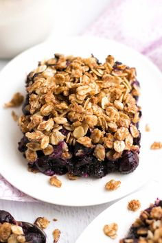 The Ultimate Healthy Blueberry Crumble Crumble -- this easy dessert is healthy enough for breakfast! It has a full serving of fruit & just 127 calories!