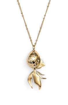 So whimsical! Sparkling crystals dot a floppy-tailed goldfish charm in a glistening pendant necklace from Kate Spade.