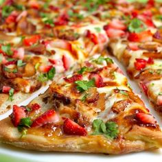 Strawberry balsamic pizza with chicken, sweet onion, and applewood bacon. Sounds delicious!