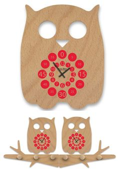 Wooden owl clock  designed by french designer Stéphane Clivier who started his own company in 2003 Reine Mèrecommittedto producin...