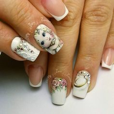 A pretty and cute rose nail art design. The design has beautiful pink flowers that match perfectly with the background cream color and at the same time, the pretty details of a little girl's face make the entire design look very vintage.