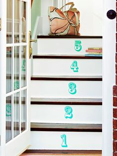 Easily spruce up your staircase using fun decals! More budget-friendly DIY projects: http://www.bhg.com/decorating/do-it-yourself/accents/budget-friendly-diy-projects/?socsrc=bhgpin080713stairdecals=3