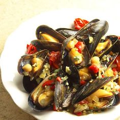 """Spanish Tapas-Inspired Mussels When you think """"mussels"""" you may not instantly think """"chickpeas,"""" but the two are joined in tasteful union in this delicious, bistro-style dish. You'll want some crusty bread to sop up the sauce. Tapas Recipes, Fish Recipes, Seafood Recipes, Cooking Recipes, Healthy Recipes, Mussel Recipes, Catering Recipes, Chickpea Recipes, Party Recipes"""