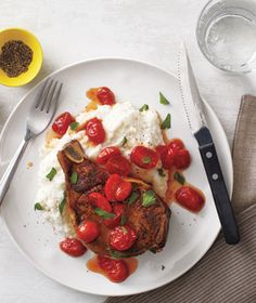 Pork Chops With Cheesy Grits and Jammy Tomatoes recipe from RealSimple.com #myplate #protein