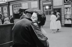 A soldier kissing a young woman goodbye before leaving for Egypt. Portsmouth Pubs, Become A Photographer, The Blitz, Young Women, Egypt, Romance, Leaves, Stock Photos, Couple Photos