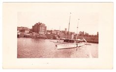 "Photo postcard of the Inner Harbour, Victoria, B.C. Vancouver Island circa 1906-1913. Moored is the U.S. Yacht ""El Primero"". John Bull (aka Belmont) Saloon on the corner of Government and Humboldt, before construction of the Belmont Building and Union Club"