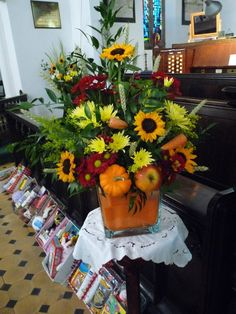 Harvest Festival flower arrangement in square glass bowl. Sunflowers, pumpkins and apples too! Church Flowers, Fall Flowers, Fresh Flowers, Wedding Flowers, Harvest Church, Fall Harvest, Large Flower Arrangements, Table Arrangements, Flower Festival