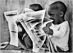 children reading newspapers