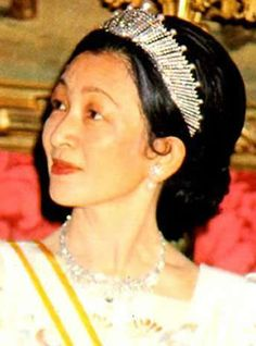 Empress Michiko of Japan, wearing the Sunburst tiara, for which there is a matching necklace.  Crown Princess Masako now wears it.